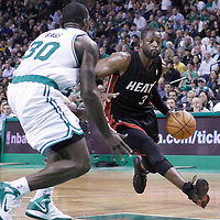 01 April 2012: Miami Heat shooting guard Dwyane Wade (3) drives past Boston Celtics power forward Brandon Bass (30) during the Boston Celtics 91-72 victory over the Miami Heat at the TD Banknorth Garden, Boston, Massachusetts, USA. NOTE TO USER: User expressly acknowledges and agrees that, by downloading and or using this photograph, User is consenting to the terms and conditions of the Getty Images License Agreement. Mandatory Credit: 2012 NBAE (Photo by Chris Elise/NBAE via Getty Images)