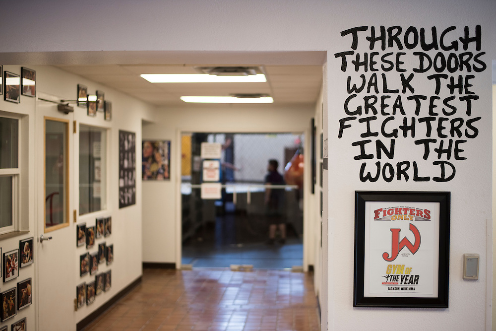 """""""Through these doors walk the greatest fighters in the world"""" written on the entrance of Jackson Wink MMA in Albuquerque, New Mexico on June 10, 2016."""