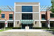 Argyros Forum Building Entrance with Statue of Albert Schweitzer on Campus at Chapman University