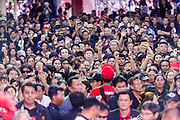 28 APRIL 2014 - BANGKOK, THAILAND: The crowd at the funeral for Kamol Duangphasuk, 45, in Bangkok. Kamol was a popular poet who wrote under the pen name Mai Nueng Kor Kunthee. Kamol had been writing since the 1980s and was an outspoken critic of the 2006 coup that deposed Thaksin Shinawatra. After the 2010 military crackdown against the Red Shirts he went into temporary self imposed exile fearing for his safety. After he returned to Thailand he organized weekly protests against Thailand's Lese Majeste laws, which he said were being used to stifle dissent. Kamol was shot and murdered on April 23. The assailants are still at large but the murder is thought to be political.     PHOTO BY JACK KURTZ