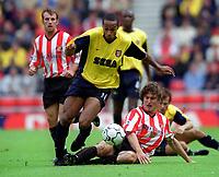 Thierry Henry (Arsenal) is tackled by Stanislav Varga (Sunderland). Sunderland 1:0 Arsenal. FA Premiership,19/8/2000. Credit Colorsport / Stuart MacFarlane.