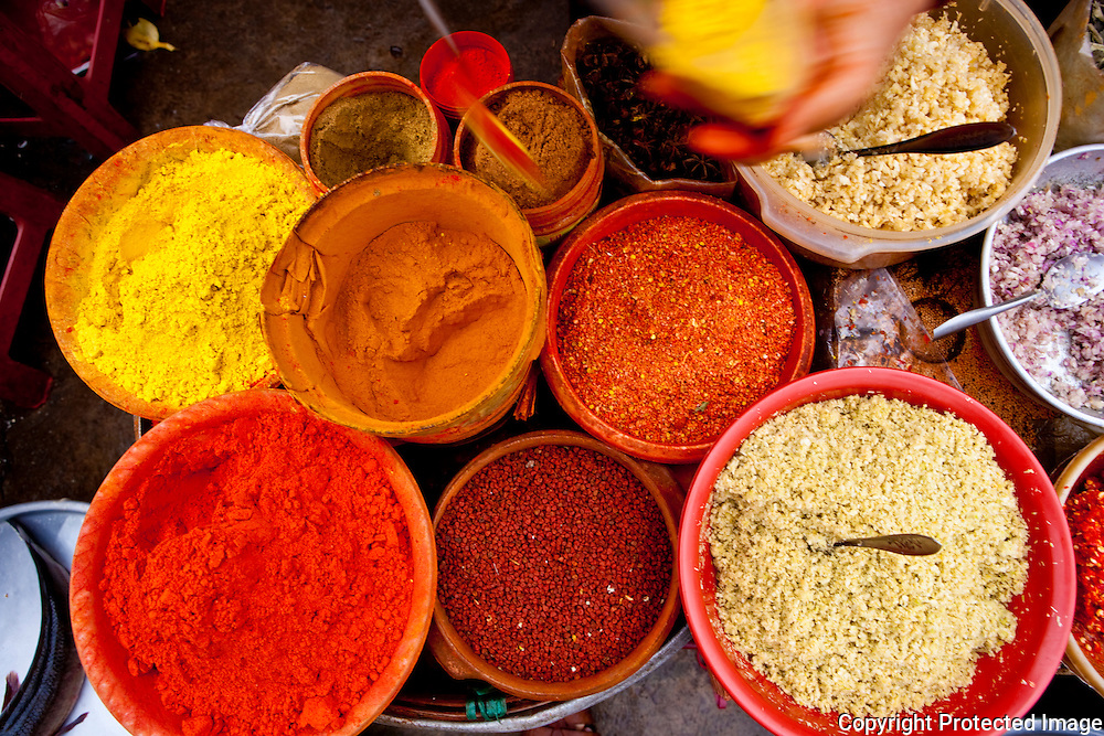 powdered spices for sale in ho chi minh city's cholon / chinatown market, vietnam