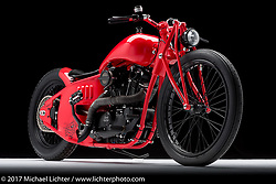 """Misfit"", a custom red sportster built from a '74 sportster by Adam Karns of Karns Kustoms in Delmar, MD. Photographed by Michael Lichter during the Easyriders Bike Show in Columbus, OH on February 11, 2017. ©2017 Michael Lichter."