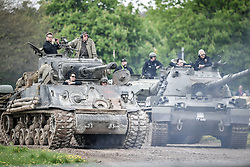 """Various tank crews watch a display on the course at the Tank Museum, Bovington, as the attraction hosts """"Tiger Day"""" to mark the 75th anniversary of the world's only working Tiger Tank's capture in 1943 in the Tunisian desert."""