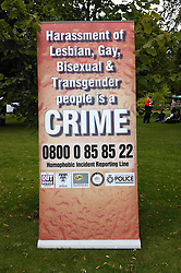 Banner displaying contact number for gay and lesbian people at the Nottingham Pride Gay Lesbian festival; held at the Arboretum,