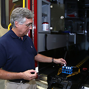 AeroClave founder Dr. Ronald Brown shows the testing methods of his built in decontamination unit, at his office in Winter Park, Florida on Friday, Oct. 10, 2014. Viruses with similar characteristics to Ebola have been tested with positive results that show the pathogens are erased. The Winter Park Fire/Rescue organization now has three ambulances equipped with self contained, built-in decontamination units – coming in the wake of an international Ebola virus scare. The units feature pressurized pumps, which release a decontamination mist inside the patient area of the ambulance. It takes about 15 minutes for the mist to cover all the surface area inside and break the chain of infection.  (AP Photo/Alex Menendez)