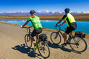 Cycling under the Southern Alps along the Tekapo Canal, Lake Tekapo, Canterbury, South Island, New Zealand