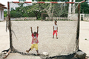 Children of workers play football at the restored Roca Boa Vista, Sao Tome. Sao Tome and Principe, are two islands of volcanic origin lying off the coast of Africa. Settled by Portuguese convicts in the late 1400s and later a centre for slaving, their independence movement culminated in a peaceful transition to self government from Portugal in 1975.