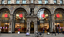 The Apple store on Regent Street, London, displays red products in recognition of World Aids Day as Apple stores across the globe go red, with a red logo and other red elements in store.