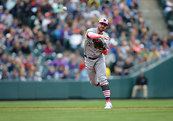 May 13, 2018 - Denver, CO, U.S. - DENVER, CO - MAY 13: Milwaukee Brewers infielder Travis Shaw (21) fields a ground ball and throws to first base during a regular season MLB game between the Colorado Rockies and the visiting Milwaukee Brewers on May 13, 2018 at Coors Field in Denver, CO. (Photo by Russell Lansford/Icon Sportswire) (Credit Image: © Russell Lansford/Icon SMI via ZUMA Press)
