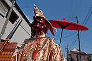 A Shinto priest in a demon mask during the Kanamara matsuri or festival of the iron phallus in Kawasaki Daishi near Tokyo, Japan. Sunday April 1st 2012