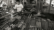 Metalworker with samples of his products in Nan Pan Market, Inle Lake, Myanmar