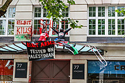 A general view shows the atmosphere on the rooftop of the entry door outside Elbit Systems HQ office at 77 Kingsway, central London after Palestine Action activists scaled Elbit's entry building on Friday morning, Aug 6, 2021. (VX Photo/ Vudi Xhymshiti)