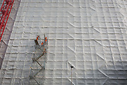 Construction workers erect a growing gantry that is tied to the side of an office building formerly Express Newspapers being renovated at the southern end of Blackfriars Bridge, on 17th October 2017, in Southwark, London, England.