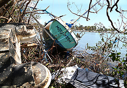 A damaged sail boat washed ashore at the Grove Key Marina in Miami, after Hurricane Irma passed over South Florida, on Tuesday, September 12, 2017. Photo by Pedro Portal/El Nuevo Herald/TNS/ABACAPRESS.COM
