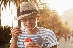 Holiday teenager sunset eating ice cream summer