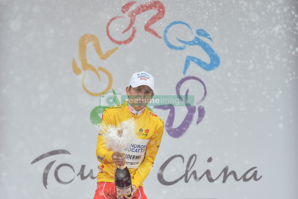 September 20, 2017 - Changde City, China - Kevin Rivera Serrano from Androni-Sidermec-Bottecchia team celebrates during the Awards Ceremony as he keeps the Yellow Leader Jersey after the second stage of the 2017 Tour of China 2, the 97.6km Changde Lixiang Circuit Race. .On Wednesday, 20 September 2017, in Lixian County, Changde City, Hunan Province, China. (Credit Image: © Artur Widak/NurPhoto via ZUMA Press)