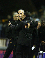 Photo: Rich Eaton.<br /> <br /> Wolverhampton Wanderers v Sunderland. Coca Cola Championship. 24/11/2006. Mick McCarthy, manager of Wolverhampton Wanderers and Roy Keane, manager of Sunderland pictured at their first meeting as managers at the end of the game embracing