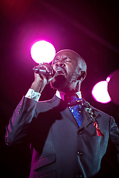 © Licensed to London News Pictures . 26/08/2013 . Manchester , UK . Musician David McAlmont sings at the event . Candlelit vigil in memory of those who have died from AIDS , in Sackville Park Manchester this evening (Monday 26th August 2013) on the final evening of Manchester Pride 2013 . The annual event is organised by the George House Trust in Manchester . Photo credit : Joel Goodman/LNP