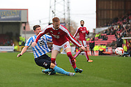 Coventry City defender Aaron Phillips tackles Swindon Town defender James Brophy during the Sky Bet League 1 match between Swindon Town and Coventry City at the County Ground, Swindon, England on 24 October 2015. Photo by Jemma Phillips.