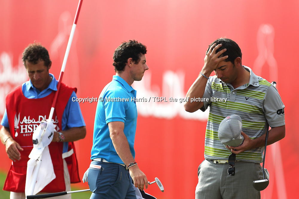 Rory MCILROY (NIR) wonders what might have been as he leaves Pablo LARAZZABAL (ESP) in disbelief that he beat him and Phil MICKLESON (USA) into joint second place after his third win on the European Tour during fourth round HSBC Abu Dhabi Championship 2014,Abu Dhabi Golf Club,Abu Dhabi,UAE.