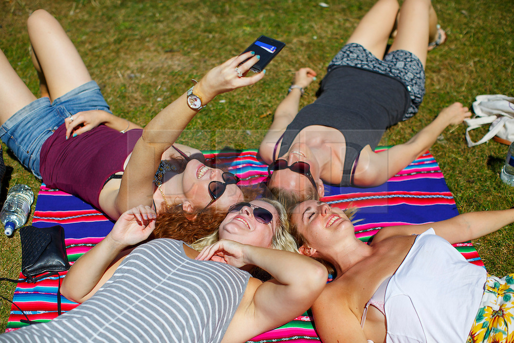© Licensed to London News Pictures. 15/08/2016. London, UK. A group of women pose for a selfie whilst enjoying hot weather and sunshine in Regent's Park, London on Monday, 15 August 2016. Photo credit: Tolga Akmen/LNP