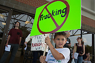 May 12, Mandeville LA,  Maximus Guy, 5 years old, holds up an anti-fracking sign in front of the Castine Center where an educational meeting about fracking was held . Maximus worries that fracking will mean no fishing for him.