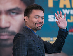 November 20, 2018 - Beverly Hills, California, U.S - Manny Pacquiao waives to the media along with Adrien Broner at a news conference on Tuesday, November 20, 2018, in Beverly Hills, California. Pacquiao will defend his World Boxing Association welterweight title against Broner on January 19, 2019, in Las Vegas. (Credit Image: © Prensa Internacional via ZUMA Wire)
