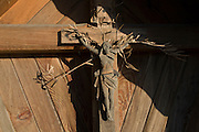Detail of a Catholic crucifix in the wine growing region of Bolzano, South Tyrol, northern Italy.