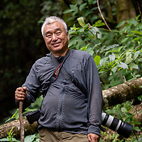 Mr Xie, Chinese photographer smiling while looking in the cmaera, Wuliangshan Nature Reserve, in Jingdong county, Yunnan Province, China.