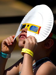 Eden Harwell, 6, of Kings Mountain, N.C. keeps her eyes and forehead shaded as she looks at the solar eclipse from atop the Discovery Place parking deck on Monday, Aug. 21, 2017 in Charlotte, N.C. Photo by Jeff Siner/Charlotte Observer/TNS/ABACAPRESS.COM