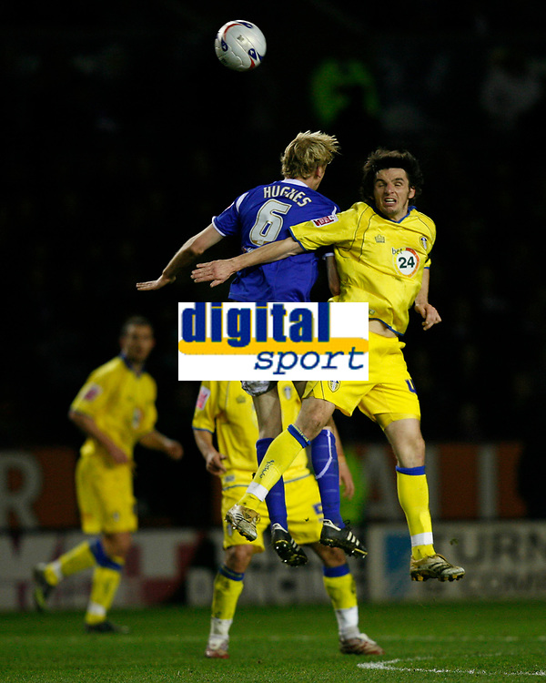 Photo: Steve Bond.<br />Leicester City v Leeds United. Coca Cola Championship. 13/03/2007. Stepehen Hughes (left) and Jonathan Douglas (right) challange for the ball