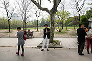 A stylishly dressed gentleman waits for his dance partner  at Fuxing Park in Shanghai, China, on Sunday, April 10, 2016. An rapidly ageing demographic is one of the main challenges facing China as society is greying before the country became a developed nation.