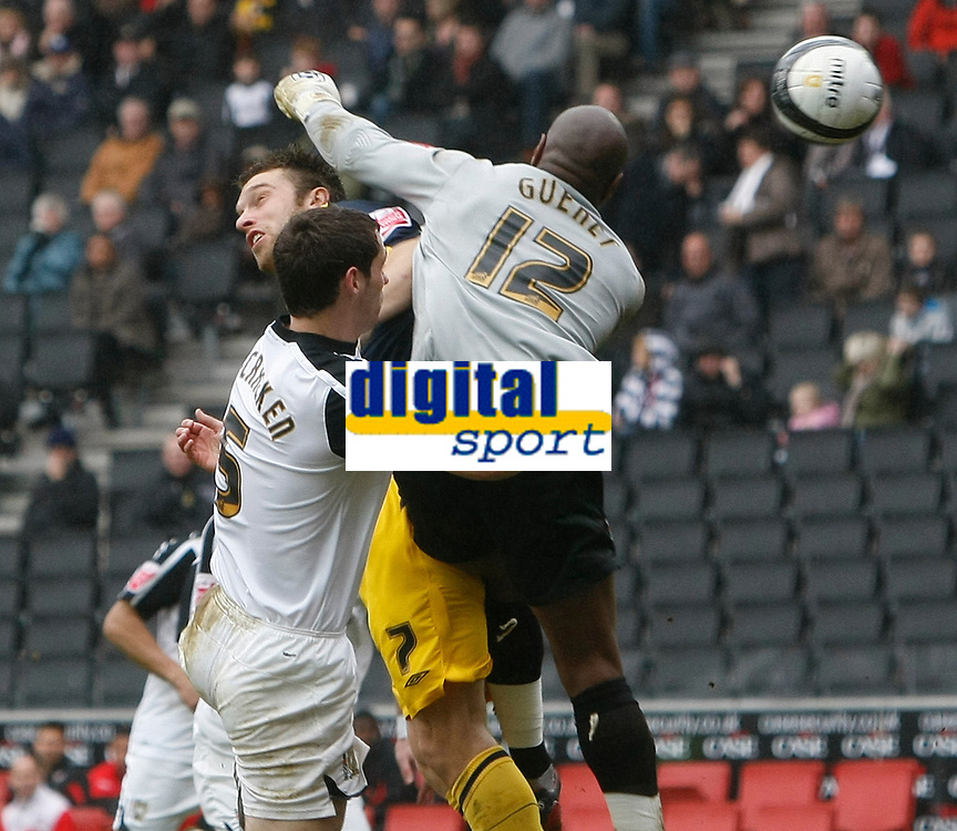 Photo: Steve Bond/Richard Lane Photography. MK Dons v Southampton. Coca-Cola Football League One. 20/03/2010. A brave header by Rickie Lambert (Yellow) opens the scoring as keeper Willy Gueret tries to punch