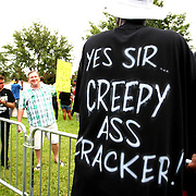 """A pro-Trayvon demonstrator wears a t-shirt that says """"Yes sir, creepy ass cracker"""", in the protest area, prior to the trial of George Zimmerman at the Seminole County Courthouse, Saturday, July 13, 2013, in Sanford, Fla. Zimmerman had been charged for the 2012 shooting death of Trayvon Martin. Zimmerman was found not guilty by a jury of six women. (AP Photo/Alex Menendez)"""