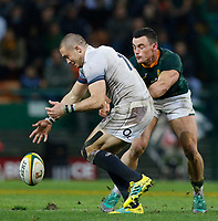 CAPE TOWN, SOUTH AFRICA - JUNE 23: England player Mike Brown picks up the ball, while South African player Jesse Kriel watches on at Newlands Stadium on June 23, 2018 in Cape Town, South Africa. (Photo by MB Media/Getty Images)