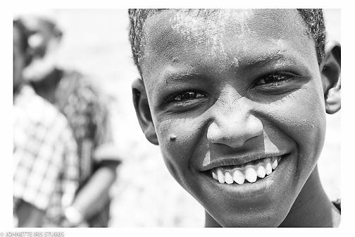 Young Afar boy  smiles in Asaita Refugee Camp, Afar, Ethiopia 2016
