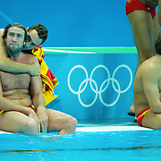 Spain's Guillermo Molina Rios, seated left, was consoled by a teammate after the men's water polo team was eliminated after an 11-9 loss to Montenegro in the quarterfinal match at the Water Polo Arena in Olympic Park during the 2012 Summer Olympic Games in London, England, Wednesday, August 8, 2012. (David Eulitt//Kansas City Star/MCT)