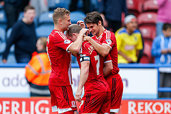 Grant Leadbitter of Middlesbrough celebrates with teammates after scoring a Penalty to ein the game 1-2 - Photo mandatory by-line: Rogan Thomson/JMP - 07966 386802 - 13/09/2014 - SPORT - FOOTBALL - Huddersfield, England - The John Smith's Stadium - Huddersfield town v Middlesbrough - Sky Bet Championship.