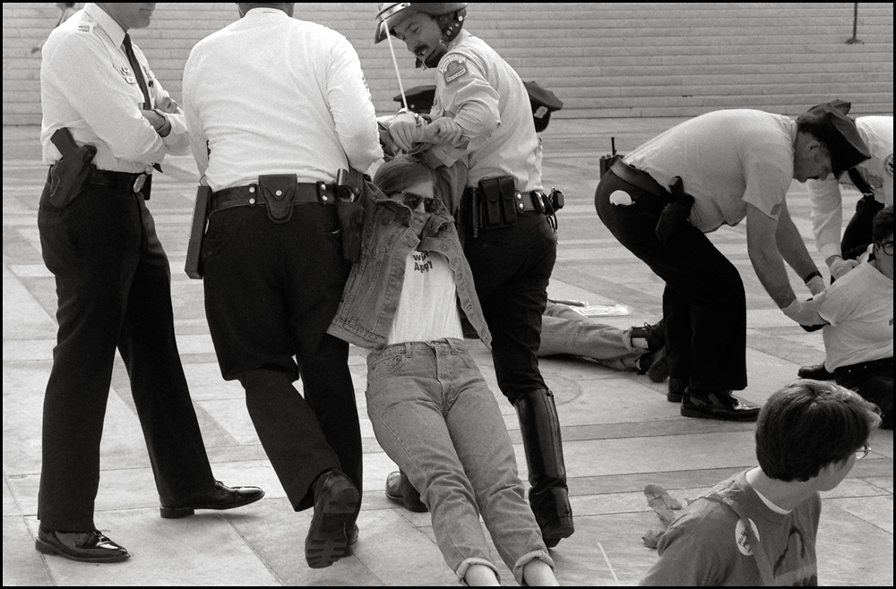 Stacey Mink of ACT UP NY and Wham! was arrested, on April 26, 1989, when abortion rights opponents, backed by the Bush Administration, urged the Supreme Court to overturn Roe v. Wade in Webster v. Reproductive Health Services. Pro-choice activists clashed with opponents outside the court, with more than two dozen demonstrators were arrested. <br /> <br /> In Webster v. Reproductive Health Services, the Court upheld several provisions of a Missouri law that regulated the performance of abortions.   The Court refused to invalidate the law's preamble stating that life begins at conception.