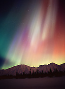 Beautiful green, red and purple aurora above the Talkeetna Mountains and Colorado Lake, geomagnetic storm during the early morning hours of March 31, 2001, Broad Pass, Alaska.