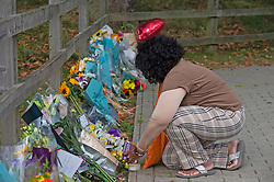 © Licensed to London News Pictures 23/09/2021. Kidbrooke, UK, A woman lighting a candle for Sabina. A large police cordon is still in place around Cator Park at Kidbrooke Village in Kidbrooke, South East London today after the body of 28 year old school teacher Sabina Nessa was found near a community centre. Police have said Sabina left her home and walked through Cator Park heading for the Depot pub at Pegler Square in Kidbrooke Village to meet a friend. Photo credit:Grant Falvey/LNP