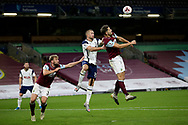 Tottenham Hotspur midfielder Eric Dier (15) and Burnley defender James Tarkowski (5) challenge for the high ball during the Premier League match between Burnley and Tottenham Hotspur at Turf Moor, Burnley, England on 26 October 2020.