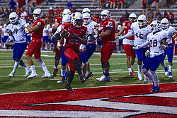 NORMAL, IL - September 07: James Robinson high steps into the end zone after navigating the middle of the Eagles defensive line during a college football game between the ISU (Illinois State University) Redbirds and the Morehead State Eagles on September 07 2019 at Hancock Stadium in Normal, IL. (Photo by Alan Look)