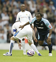 Photo: Aidan Ellis.<br /> Leeds United v Swansea City. Coca Cola League 1. 22/09/2007.<br /> Swansea's Jason Scotlland goes past Leeds Johnathon Douglas