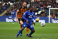 Cardiff City midfielder Junior Hoilett (33) in possession watched by Hull City midfielder David Meyler (8) during the EFL Sky Bet Championship match between Hull City and Cardiff City at the KCOM Stadium, Kingston upon Hull, England on 28 April 2018. Picture by Mick Atkins.