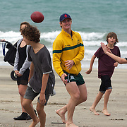 Berrick Barnes, (centre), along with team mates Will Genia and Luke Burgess (not on photograph) , playing rugby with locals during the Australian teams recovery session at  Takapuna Beach at the IRB Rugby World Cup tournament, Auckland, New Zealand, 17th October 2011. Photo Tim Clayton...