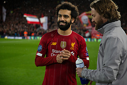 LIVERPOOL, ENGLAND - Wednesday, March 11, 2020: Liverpool's Mohamed Salah with head of fitness and conditioning Andreas Kornmayer during the UEFA Champions League Round of 16 2nd Leg match between Liverpool FC and Club Atlético de Madrid at Anfield. (Pic by David Rawcliffe/Propaganda)
