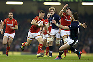 Gareth Davies of Wales (c) makes a break to score his try.RBS Six nations championship 2016, Wales v Scotland at the Principality Stadium in Cardiff, South Wales on Saturday 13th February 2016. <br /> pic by  Andrew Orchard, Andrew Orchard sports photography.