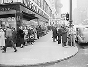 Y-511115-01. Crowds at SW Broadway and Washington await the start of the parade honoring General MacArthur. November 15, 1951